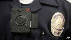 FILE - This 2014 photo shows a Los Angeles Police officer wearing an on-body cameras during a demonstration for media in Los Angeles.