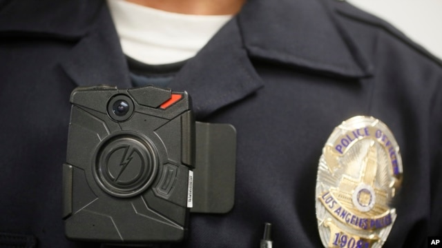 FILE - A Los Angeles police officer is shown wearing an on-body camera during a demonstration for media in Los Angeles. Thousands of police agencies have equipped officers with cameras to wear with their uniforms.