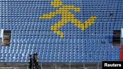 Sportsmen train at a local stadium in the southern city of Stavropol, Russia, Nov. 10, 2015.