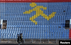 FILE - Athletes train at a local stadium in the southern city of Stavropol, Russia, Nov. 10, 2015.
