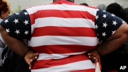 FILE - In this May 8, 2014, file photo, an overweight person is seen in New York. As obesity rates climb in the U.S., more Americans say they're following special diets compared to a decade ago. (AP Photo/Mark Lennihan, File)