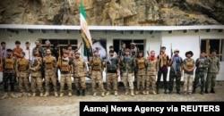 FILE - Men prepare for defense against the Taliban in Panjshir, Afghanistan, Aug. 22, 2021. (Aamaj News Agency via Reuters)