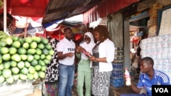 Tech entrepreneur Tomi Ayorinde of MobileForms, and three of his colleagues, visit a market in the Nigerian capital of Abuja to poll vendors on the price of their goods.
