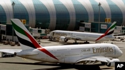 FILE - Emirates passenger planes are seen at Dubai airport in United Arab Emirates.