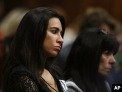 Kim Myers, a friend of the late Reeva Steenkamp, listens to a witness testify at the murder trial of Oscar Pistorius, in Pretoria, South Africa, on May 6, 2014