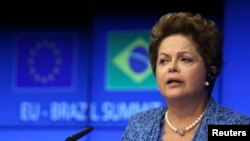Brazil's President Dilma Rousseff speaks at a joint news conference with European Council President Herman Van Rompuy and EU Commission President Jose Manuel Barroso (unseen) during an EU-Brazil summit in Brussels, Feb. 24, 2014.