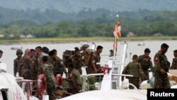 FILE - Myanmar soldiers arrive after Arakan Rohingya Salvation Army's (ARSA) attacks, at Buthidaung, Myanmar, Aug. 29, 2017.