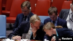 British Ambassador to the United Nations Matthew Rycroft speaks with U.S. Ambassador to the United Nations Samantha Power during a high level meeting on Syria by the United Nations Security Council at the United Nations in Manhattan, New York, Sept. 25, 2