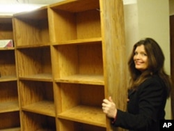 Rebecca Maitland and historian John Ritter found a long-forgotten room behind this bookcase in the basement of a Salem office building.