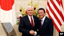 U.S. Vice President Mike Pence and Japanese Deputy Prime Minister and Finance Minister Taro Aso. (April 18, 2017)
