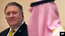 U.S. Secretary of State Mike Pompeo, left, listens to Saudi Arabia's Foreign Minister Adel al-Jubeir, during a joint press conference at the Royal Terminal of King Khaled airport, in Riyadh, Saudi Arabia, Sunday, April 29, 2018. ob
