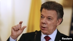 FILE - Colombian President Juan Manuel Santos, shown speaking at a Washington news conference, Feb. 5, 2016.