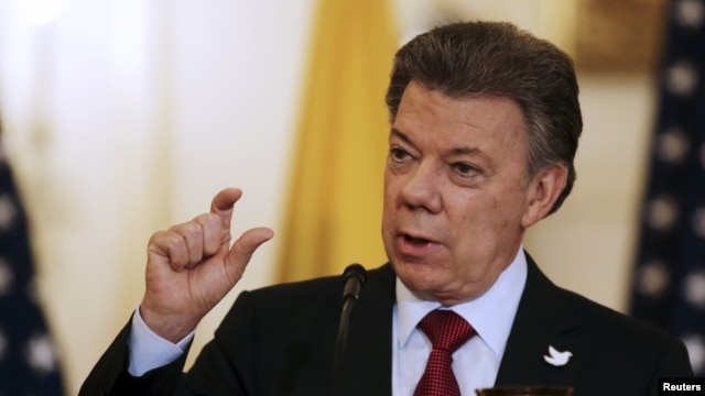 Colombian President Juan Manuel Santos, shown speaking at a Washington news conference, Feb. 5, 2016, says U.S. medical investigators will soon arrive in his country to help investigate the Zika virus.