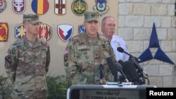 Maj. Gen. John Uberti, deputy commanding general III Corps and Fort Hood, speaks to the media outside the Marvin Leath Visitors Center at Fort Hood, Texas, June 3, 2016.