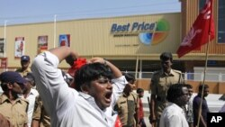 India's leftist party activists shout slogans during a protest in front of a Bharti Walmart Best Price wholesale store in Hyderabad, India, November 19, 2102.