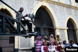 "FILE - A cameraman films a scene from a crane during the making of ""Ake,"" a film based on the childhood memoirs of Nigerian writer Wole Soyinka, in Abeokuta, southwest Nigeria, July 14, 2013. Nigeria's movie business, often known as Nollywood, is one of the biggest in the world."