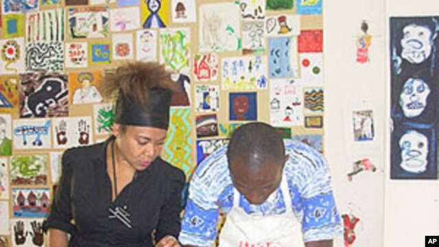 Art therapist Felicity Kodjo watches over a patient during the art therapy workshop.