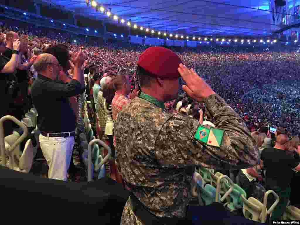 A military policeman salutes during the playing of Brazil's national anthem at beginning of the Rio Olympics' opening ceremonies in Maracana Stadium, Rio de Janeiro, Brazil, Aug. 5, 2016.