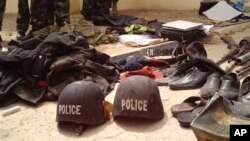 Soldiers stand behind items recovered from suspected Boko Haram members, Bukavu Barracks in Kano, Nigeria, March 21, 2012 (file photo).