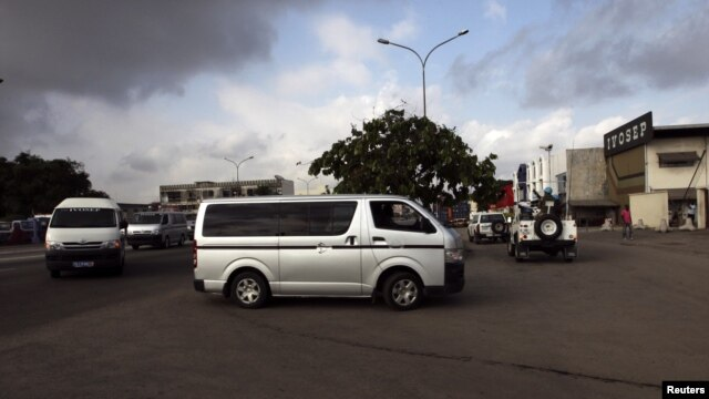 Hearses carrying the bodies of the United Nations peacekeepers killed in western Ivory coast near the Liberia border, arrive at IVOSEP mortuary in Abidjan, June 9, 2012.