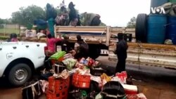 Arrested Gold Panners Unloading Belongings At Gwanda Station