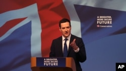 "FILE - Britain's treasury chief, George Osborne, is seen speaking to a meeting of Conservative party members in Swindon, England, April 14, 2015. He argues, for Britain to leave the EU, would be ""an extraordinary self-inflicted wound."""