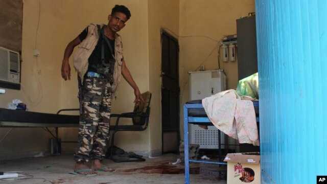 A Yemeni man inspects an elderly care home after it was attacked by gunmen in the port city of Aden, Yemen, March 4, 2016. Unidentified gunmen stormed a retirement home, killing more than a dozen people.