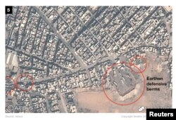 Islamic State defensive preparations in the city of Mosul are pictured ahead an impending battle with Iraqi troops in this Oct. 31, 2016 satellite handout photo.