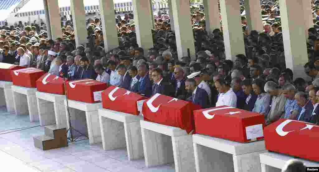 Coffins with victims of the thwarted coup are lined up for a funeral service in Ankara, Turkey.