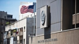 A United States flag flutters outside the U.S. Embassy in Tel Aviv, Israel, August 4, 2013.