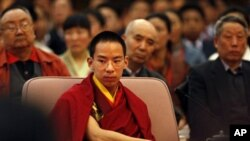 "The Chinese-appointed Panchen Lama, Gyaltsen Norbu, the boy chosen by China as the reincarnation of the 10th Panchen Lama, attends a ceremony marking the newly created ""Serf Liberation Day"" in Beijing, China, Friday, March 27, 2009."