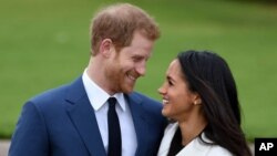 Prince Harry and Meghan Markle pose during an official photocall to announce thier engagement at The Sunken Gardens at Kensington Palace on Nov. 27, 2017 in London, England.