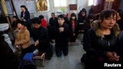 中國天津一個地下教會進行禮拜祈禱。(資料圖片)