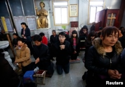 FILE - Believers take part in a weekend mass at an underground Catholic church in Tianjin .