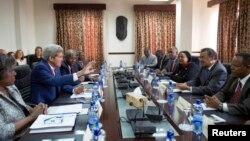 U.S. Secretary of State John Kerry (2nd L) participates in a meeting with Ethiopian Minister of Foreign Affairs Tedros Adhanom (2nd R), Kenyan Foreign Minister Amina Mohamed (3rd R) and Ugandan Foreign Affairs Minister Sam Kutesa (R) in Addis Ababa, May 1