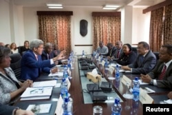 John Kerry (2nd L) participates in a meeting with Ethiopian Minister of Foreign Affairs Tedros Adhanom (2nd R), Kenyan FM Amina Mohamed (3rd R) and Ugandan FM Sam Kutesa (R) in Addis Ababa, May 1.