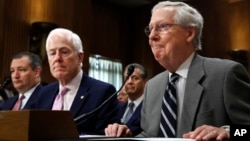 FILE - Sen. Ted Cruz, R-Texas, left, Senate Majority Whip Sen. John Cornyn, R-Texas, and Senate Majority Leader Mitch McConnell of Ky., testify in favor of ambassador nominees during a Senate Foreign Relations Committee hearing.