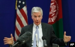 FILE - Then- U.S. ambassador to Afghanistan Ryan Crocker gestures during a press conference at the U.S. Embassy in Kabul, Dec. 10, 2011