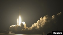 An H-2A rocket carrying four satellites including one from South Korea blasts off from the launching pad at Tanegashima Space Center on the Japanese southwestern island of Tanegashima, May 18, 2012