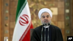 Iranian President Hassan Rouhani speaks at a news conference in Tehran, Iran, Jan. 17, 2016. On Monday, Iran's Foreign Ministry called new U.S. sanctions targeting the country's ballistic missile program illegitimate.