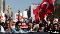 Demonstrators shout slogans during an anti-government protest in Istanbul's Kadikoy district Sept. 15, 2013.