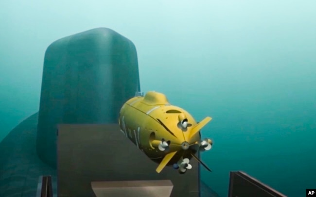 In this video grab provided by RU-RTR Russian television via AP television on Thursday, March 1, 2018, a computer simulation shows a Russian nuclear-powered underwater drone being released by a submarine.