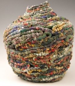 """Jackie Abrams' work """"A Woman of Substance"""" is made from pieces of women's clothing"""