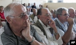 FILE: Zimbabwean farmers attend a meeting of white commercial farmers in capital Harare.