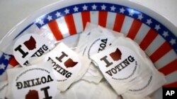 I voted stickers are seen at a polling place, Sunday, March 15, 2020, in Steubenville, Ohio.