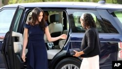 Meghan Markle, left, and her mother, Doria Ragland, arrive at Cliveden House Hotel, in Berkshire, England, May 18, 2018, to spend the night before her wedding to Prince Harry on May 19.