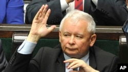 FILE - The leader of the ruling Law and Justice party, Jaroslaw Kaczynski, casts a vote in parliament in Warsaw, Poland, July 20, 2017.