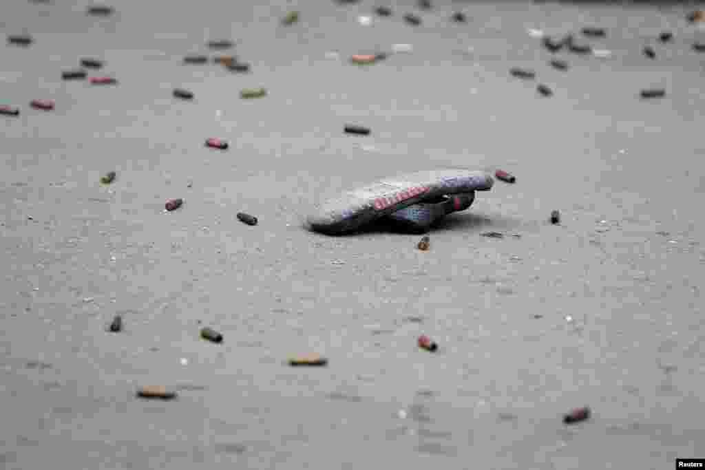 A slipper is seen amid bullet casings in the Ain el-Hilweh Palestinian refugee camp in southern Lebanon.