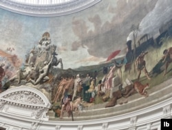 Frescoes on the ceiling of Bourse de Commerce, housing the Pinault Collection, depict colonial-era trade. (L. Bryant/VOA)