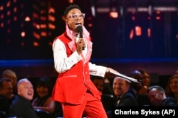 "FILE - This June 9, 2019 file photo shows Billy Porter speaking at the Tony Awards in New York. Porter's outfit was made from curtains from the Tony Award-winning musical ""Kinky Boots."" He and other celebrities are wearing more vintage pieces."